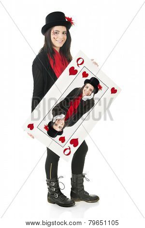 A beautiful teen girl happily holding a giant playing card containing her own