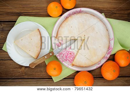 Cut Clementine Pie With Clementines And Knife On Wooden Background Top View