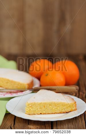 Cut Clementine Pie With Clementines And Knife On Wooden Background