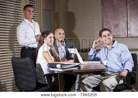 Office Workers In Boardroom Watching Presentation