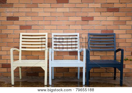 Chair And Brick Wall