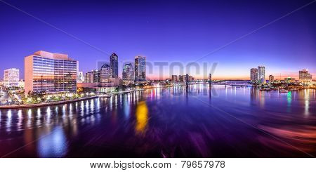 Jacksonville, Florida, USA city skyline panorama on St. Johns River at dawn.