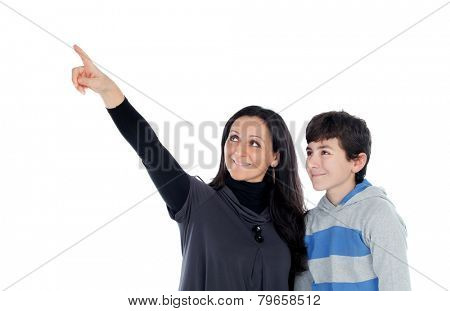 Brunette mother showing something at his teenager son isolated on a white background