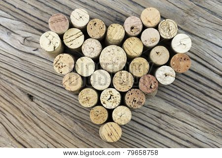 Wine Corks Form A Heart Shape Image On The Middle Of Wood Board Background