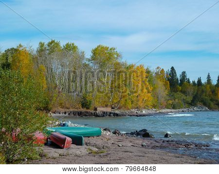 Canoes On Rocky Beach