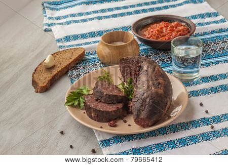 Ring Pudding Sausages On A Plate With Glass Of Vodka