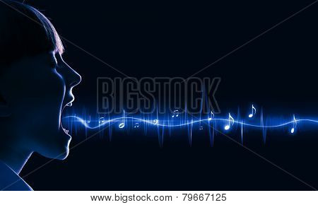 Side view of girl of school age and voice coming out of her mouth