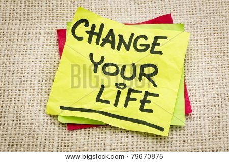 change your life - advice on a sticky note against burlap canvas