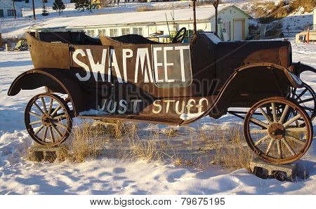 Antique Car in Snow at Sunset