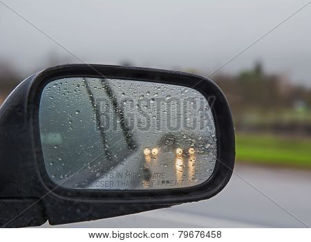 Driving In Rain With Side Mirror In Drops