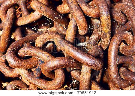 Heavy red rusty metallic chain.