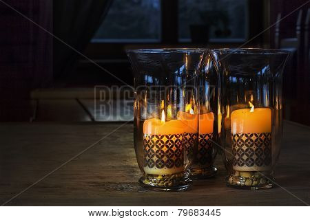 Three Candles With Ornaments In A Glass Holders