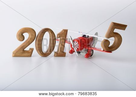 New Year 2015 Sign Made By Wooden Number And Toy Airplane