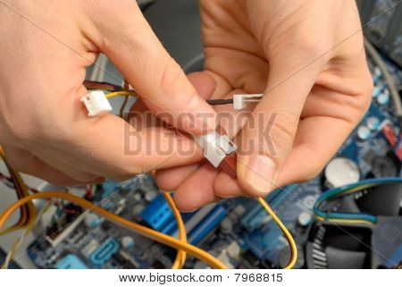 Technician's Hands At Work