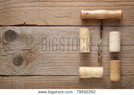 Wine Corks And Corkscrew On Wooden Background
