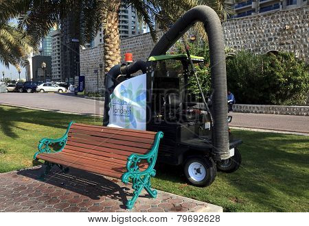 Machine for cleaning debris on lawns and sidewalks.