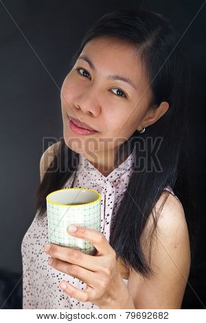 Portrait Of An Asian Girl Drinking Tea