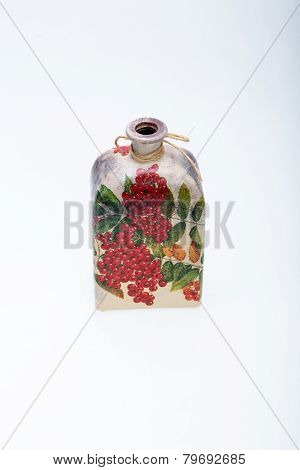 bottle decorated using different techniques of decoupage