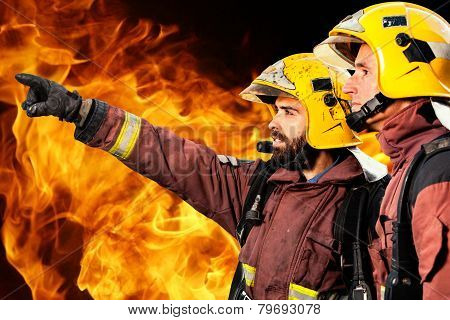 Two Firemen Analyzing Fire.