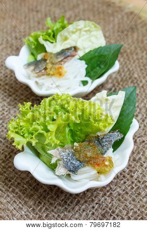Fried Mackerel Served With Boiled Thai Rice Vermicelli.
