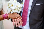 foto of indian  - Beautiful indian bride and caucasian groom after wedding ceremony - JPG