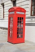 stock photo of phone-booth  - typical English phone booth in a street of london - JPG