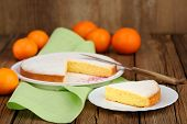 stock photo of clementine-orange  - Cut clementine pie with clementines and knife on wooden background horizontal - JPG