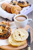 foto of bagel  - Homemade bagels with butter and cup of coffee - JPG