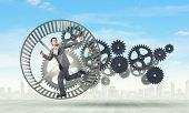 picture of hamster  - Young businessman in suit running in hamster wheel - JPG
