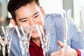 image of household  - Korean man buying glasses or household items - JPG
