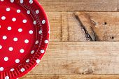 stock photo of gizmo  - Spanish dishes with red polka dots on wooden table - JPG