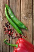 stock photo of cayenne pepper  - peppers cayenne peppers and pepper on wooden table - JPG