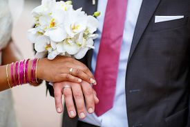 pic of indian  - Beautiful indian bride and caucasian groom after wedding ceremony - JPG