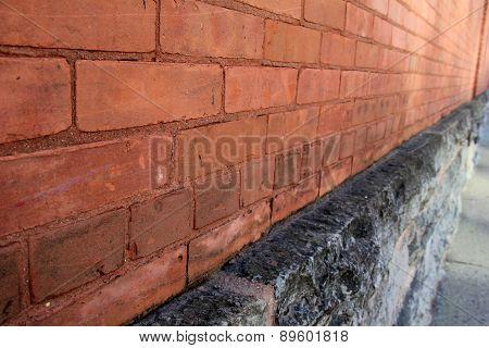Long red and black brick wall