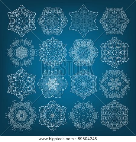 Set of 6 pointed snowflakes isolated on blue, vector illustration