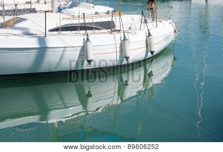 White boat moored in green water