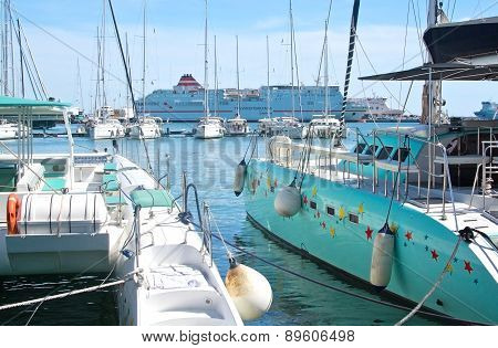 Moored catamarans and large Acciona Trasmediterranea ferry Fortuny in harbor