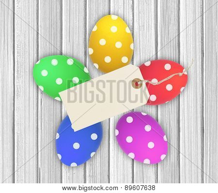Colorful Easter Eggs With Tag Card Over Wooden Background