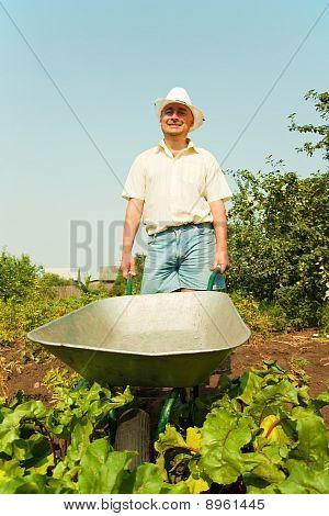 Farmer Holding Barrow