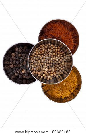 Curry, Pepper,  Paprika And Coriander - White Background.