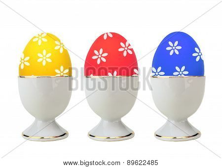 Colorful Easter Eggs In Stand Isolated On White