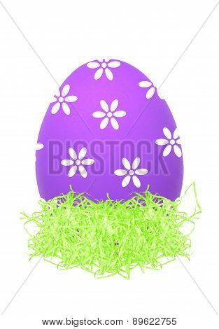 Easter Egg In Little Bird Nest Isolated On White