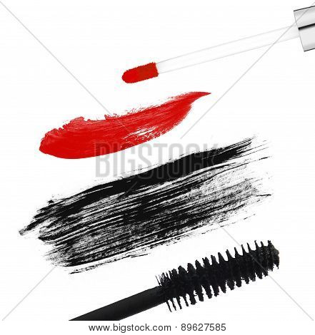 Stroke (sample) Of Black Mascara And Lip Gloss, Isolated On White Macro