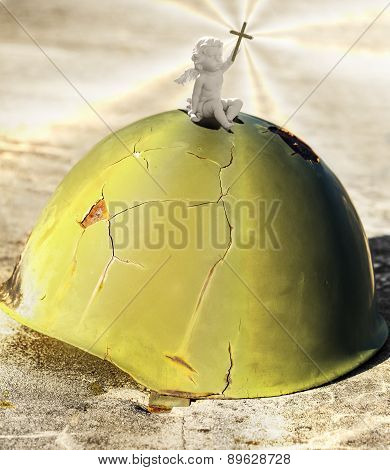 Angel Sitting On A War Helmet.
