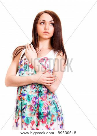 Beautiful Young Woman In A Bright Many-coloured Dress