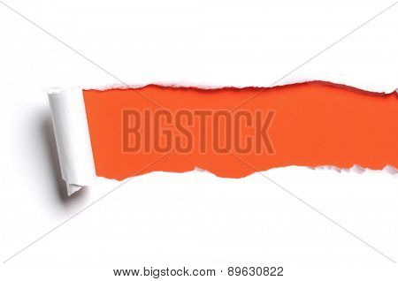 Torn white paper with orange color as background