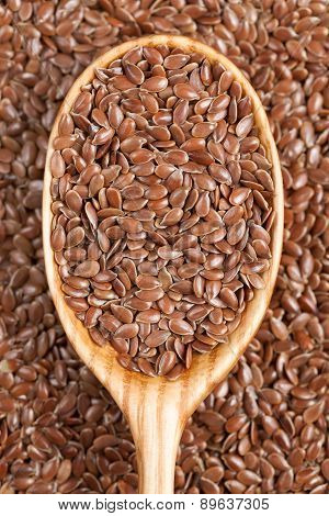 Healthy little brown flax seeds super foods  in wooden spoon