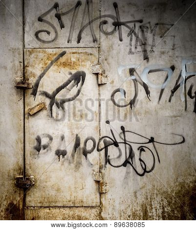 Urban Art Sprawl On Ancient Metal