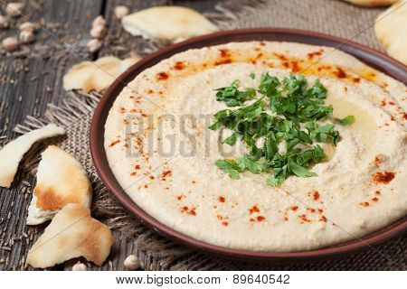 Hummus, healthy lebanese traditional creamy food with chick-peas, tahini and pita
