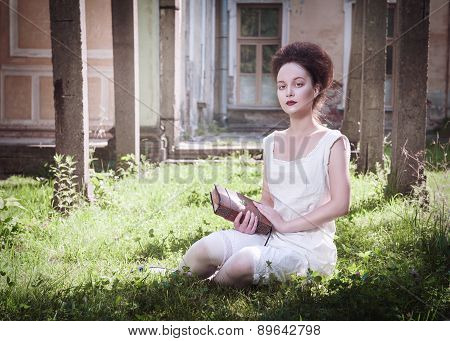 Beautiful Young Gothic Girl In White Shirt With Book